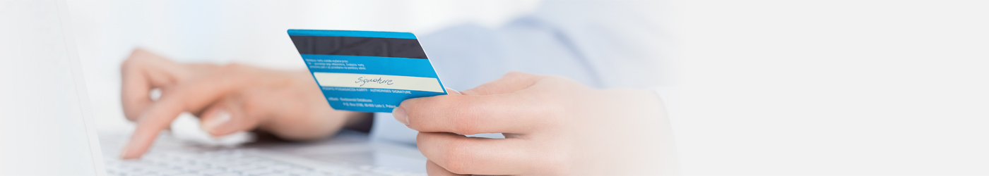 picture of woman holding credit card