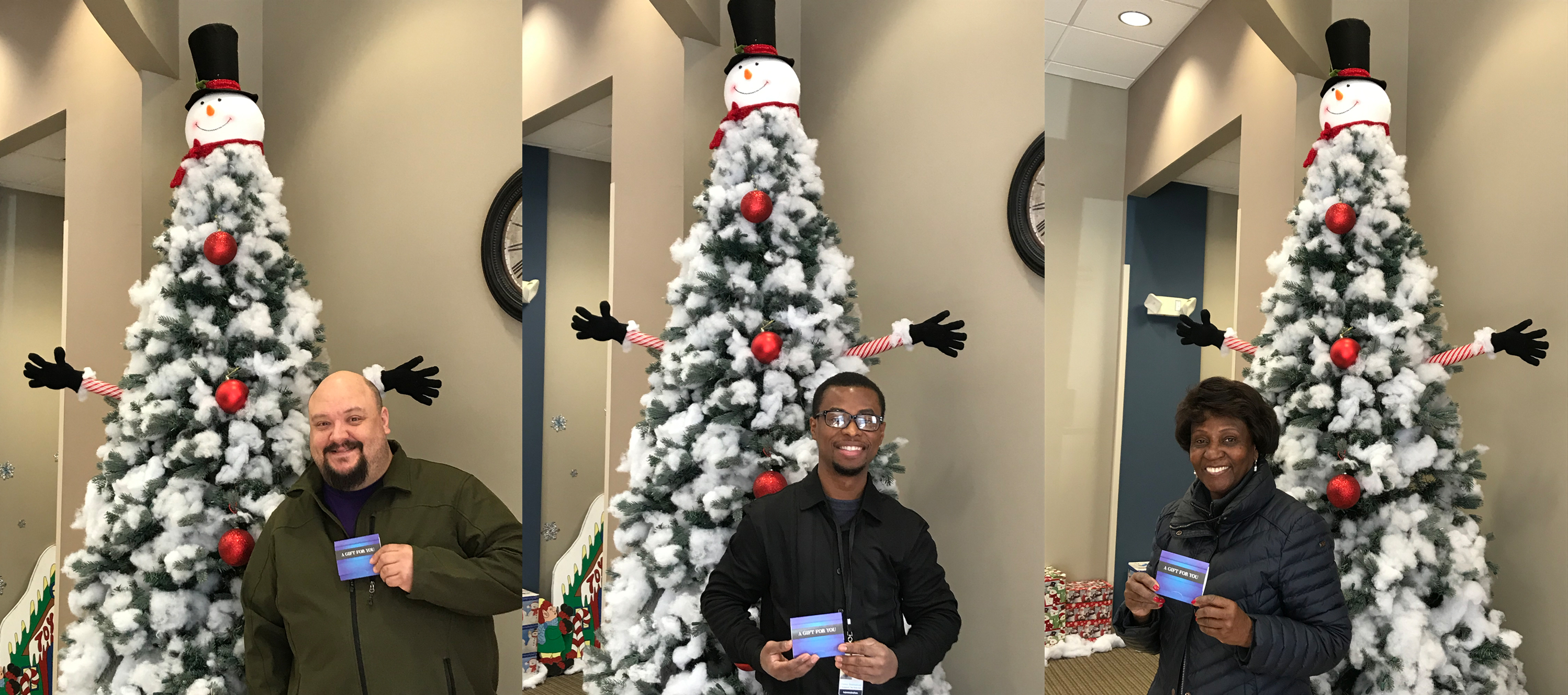 Fighting childhood disease raffle winners in front of Christmas tree