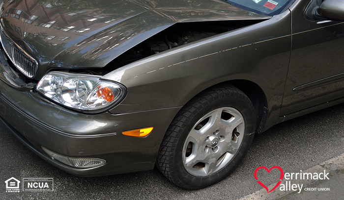 bent hood on a dark gray car