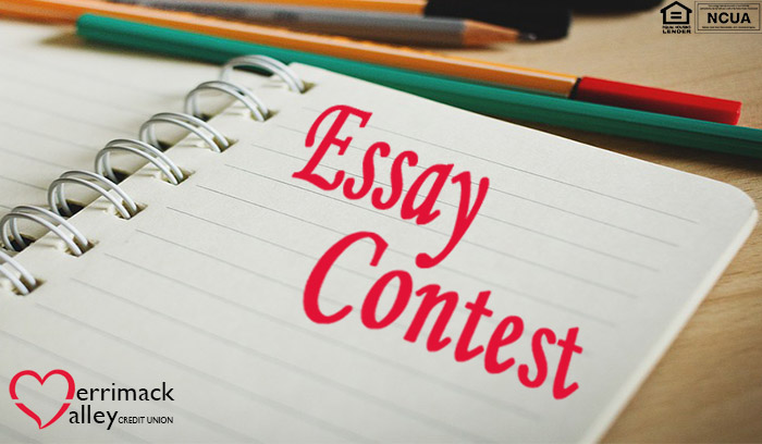 "notebook with words ""essay contest"", colored pencils"