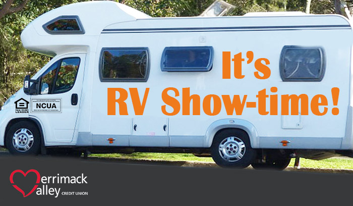"white camper vehicle with orange words ""It's RV show-time!"" on road"